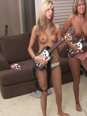 Pictures of teen star Angel Woods playing some nude guitar hero with her friend