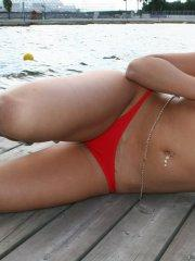 Pictures of Briana Devil flashing from behind her bikini