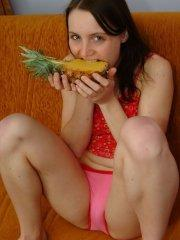 Pictures of teen Cherry Caprice getting intimate with a pineapple