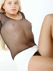 Pictures of GBD Vicky teasing in fetish net nylon in the studio