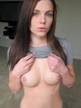 Pictures of a cute brunette girlfriend fingering her pussy