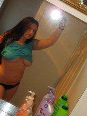 Pictures of teen GND Kayla showing off her big round boobies