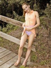 Pictures of teen girl Jenny Heart touching herself outside