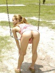 Pictures of teen model Jenny Heart exposing herself in a public park