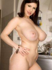Pictures of Karina Hart toying her wet pussy in the kitchen