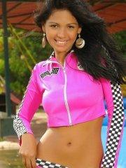 Pictures of teen Karla Spice teasing in a racer outfit