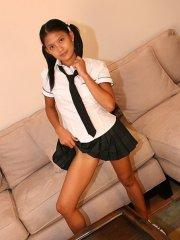 Kat Young strips wearing a school girl uniform