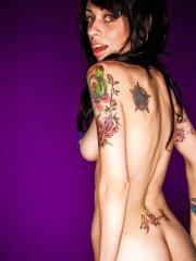 Pictures of Kayden 420 showing her naked tattooed body