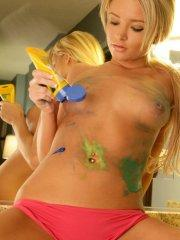 Pictures of teen babe Kiss Kara getting covered in body paint