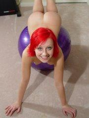 Pictures of Lindsey Marshal playing with a giant ball
