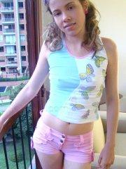 Pictures of teen girl Little Liana hanging out at home