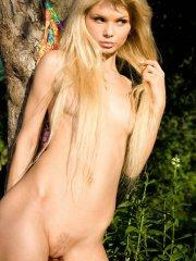 Pictures of teen model Lolly Hardcore all nude in the woods