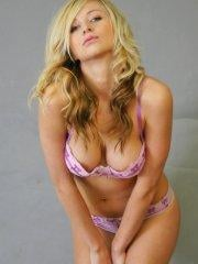Pictures of London Hart teasing in purple lingerie