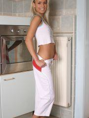 Pics of teen cutie Mandy Lightspeed teasing in the kitchen