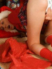 Pictures of teen babe Michelle Lynn opening her presents xmas morning
