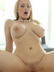 Busty blonde babe Angel Wicky takes a load on her big boobs