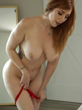 Lauren Phillips Puts Out in Red Dress