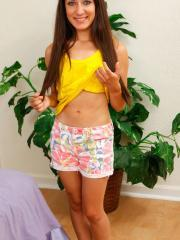 Brunette teen Freya Von Doom gets naked and touches herself in bed