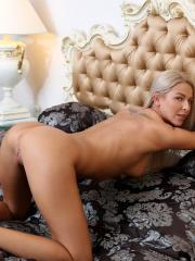 Blonde babe Karol Lilien gives you her amazing body in bed