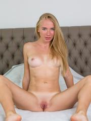 Stunning blonde Jenna Y strips out of her dress and waits for you in bed