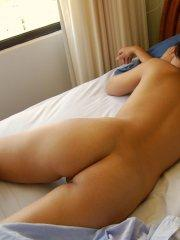 Pictures of Roxy Rhodes sleeping in the nude