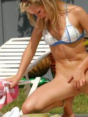 Pictures of Teen Kasia fingering her pussy by the pool