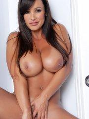 Pictures of Lisa Ann toying her tight pussy