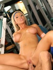 Busty blonde Tanya James fucks her personal trainer in the gym
