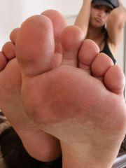 Pictures of True Tere showing off her long legs and sexy feet