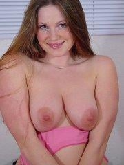 Pictures of Vicki Model giving you her tits in bed