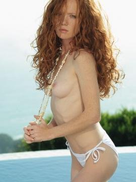 Pictures of a hot redhead girl getting naked by the pool